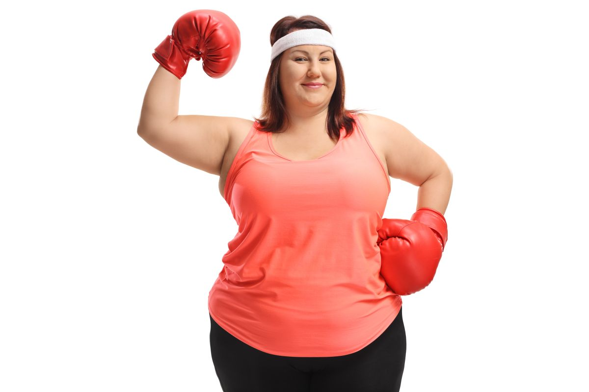Overweight,Woman,With,Boxing,Gloves,Flexing,Her,Biceps,Isolated,On